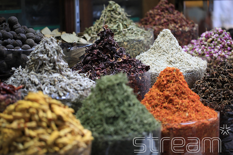 Selection of spices, piled high, on display in a market.