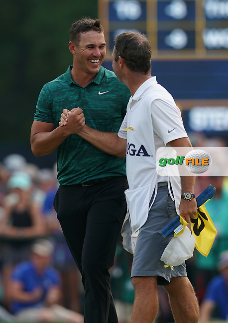 Brooks Koepka(USA) celebrates winning the 100th PGA Championship with his caddie Ricky Elliott at Bellerive Country Club, St. Louis, Missouri.<br /> Picture Tom Russo / Golffile.ie<br /> <br /> All photo usage must carry mandatory copyright credit (© Golffile | Tom Russo)