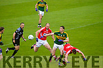 David Moran Kerry in action against Alan O'Connor Cork in the Munster Final at Fitzgerald Stadium, Killarney on Saturday evening.