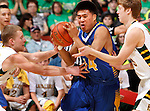 RAPID CITY, S.D. MARCH 20, 2015 -- Teal Brave Bird #14 of Little Wound drives through Aberdeen Roncalli defenders during their semi-final game at the 2015 South Dakota State A Boys Basketball Tournament at the Don Barnett Arena in Rapid City, S.D.  (Photo by Dick Carlson/Inertia)