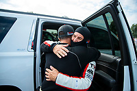 Sep 29, 2019; Madison, IL, USA; NHRA top fuel driver Steve Torrence (left) hugs father Billy Torrence during the Midwest Nationals at World Wide Technology Raceway. Mandatory Credit: Mark J. Rebilas-USA TODAY Sports