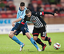 Forfar's Chris Templeman and Pars' Ryan Wallace challenge for the ball.