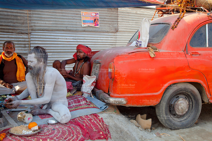 India. Uttar Pradesh state. Allahabad. Maha Kumbh Mela. A Naga (naked) Sadhu sits on a carpet near an Ambassador car at Sangam. People attend spiritual discourses under the tent. The Kumbh Mela, believed to be the largest religious gathering is held every 12 years on the banks of the 'Sangam'- the confluence of the holy rivers Ganga, Yamuna and the mythical Saraswati. In Hinduism, Sadhu (good; good man, holy man) denotes an ascetic, wandering monk. Sadhus are sanyasi, or renunciates, who have left behind all material attachments. They are renouncers who have chosen to live a life apart from or on the edges of society in order to focus on their own spiritual practice. The significance of nakedness is that they will not have any worldly ties to material belongings, even something as simple as clothes. A Sadhu is usually referred to as Baba by common people. The Maha (great) Kumbh Mela, which comes after 12 Purna Kumbh Mela, or 144 years, is always held at Allahabad. Uttar Pradesh (abbreviated U.P.) is a state located in northern India. 13.02.13 © 2013 Didier Ruef