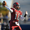 Glen Cove quarterback No. 12 Mike Payton throws a pass during a Nassau County varsity football Conference III semifinal against Bethpage at Hofstra University on Saturday, Nov. 14, 2015. Glen Cove won by a score of 21-0.<br /> <br /> James Escher