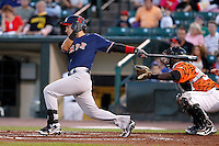 Pawtucket Red Sox infielder Jose Iglesias #10 at bat in front of catcher Jair Fernandez during a game against the Rochester Red Wings at Frontier Field on August 30, 2011 in Rochester, New York.  Rochester defeated Pawtucket 8-6.  (Mike Janes/Four Seam Images)