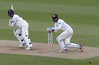 Ryan ten Doeschate of Essex and Ben Foakes of Surrey watch the ball run for four runs during Surrey CCC vs Essex CCC, Specsavers County Championship Division 1 Cricket at the Kia Oval on 13th April 2019