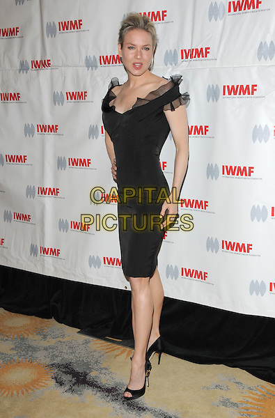 RENEE ZELLWEGER .attends The International Women's Media Foundation's Courage in Journalism Awards held at The Beverly Hills Hotel in Beverly Hills, California, USA, October 16th 2008                                                                     .full length black ruffle trim dress off the shoulder open toe shoes hand on hip .CAP/DVS.©Debbie VanStory/Capital Pictures