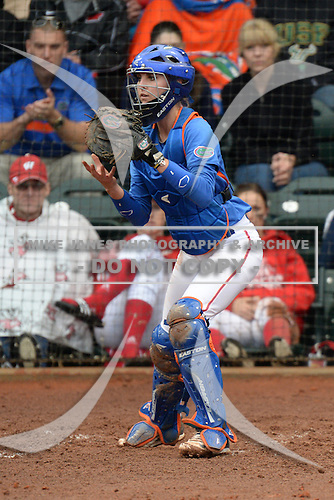 Florida Gators catcher Aubree Munro (1) during a game against the Michigan Wolverines on February 8, 2014 at the USF Softball Stadium in Tampa, Florida.  Florida defeated Michigan 9-4 in extra innings.  (Copyright Mike Janes Photography)