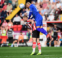 Lincoln City's Danny Rowe vies for possession with Tranmere Rovers' Jake Caprice<br /> <br /> Photographer Chris Vaughan/CameraSport<br /> <br /> The EFL Sky Bet League Two - Lincoln City v Tranmere Rovers - Monday 22nd April 2019 - Sincil Bank - Lincoln<br /> <br /> World Copyright © 2019 CameraSport. All rights reserved. 43 Linden Ave. Countesthorpe. Leicester. England. LE8 5PG - Tel: +44 (0) 116 277 4147 - admin@camerasport.com - www.camerasport.com
