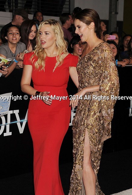 LOS ANGELES, CA- MARCH 18: Actresses Kate Winslet (L) and Shailene Woodley arrive at the Los Angeles premiere of 'Divergent' at Regency Bruin Theatre on March 18, 2014 in Los Angeles, California.