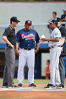 Pulaski Yankees manager Tony Franklin (18) meets at home plate with Danville Braves manager Robinson Cancel (38) and umpires Mark Bass (left) and Mike Snover prior to the start of their Appalachian League game at American Legion Post 325 Field on July 31, 2016 in Danville, Virginia.  The Yankees defeated the Braves 8-3.  (Brian Westerholt/Four Seam Images)