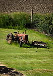 Old tractor in the fields it once plowed