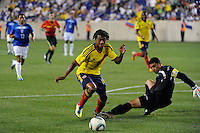 Juan G. Cuadrado (10) of Colombia tries to get past Honduras  goalkeeper Noel Valladares (18). The men's national teams of Colombia (COL) defeated Honduras (HON) 2-0 during an international friendly at Red Bull Arena in Harrison, NJ, on September 03, 2011.