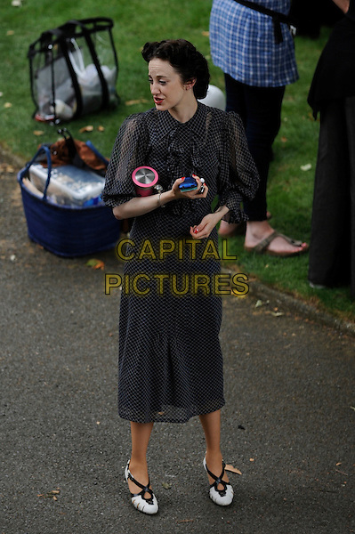 """ANDREA RISEBOROUGH.on the set of Madonna's new movie """"WE"""" in London, England, UK, July 25th 2010. *Exclusive All-Rounder*.full length forties black print dress period costume film set filmset on location shoes.CAP/IA.©Ian Allis/Capital Pictures."""