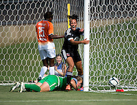 Lianne Sanderson (10) of the D.C. United Women celebrates her goal with Robyn Jones (39) and Sabbath McKiernan Allen (15) of the Charlotte Lady Eagles close by during the game at the Maryland SoccerPlex in Boyds, Maryland.  The D.C. United Women defeated the Charlotte Lady Eagles, 3-0, to win the W-League Eastern Conference Championship.