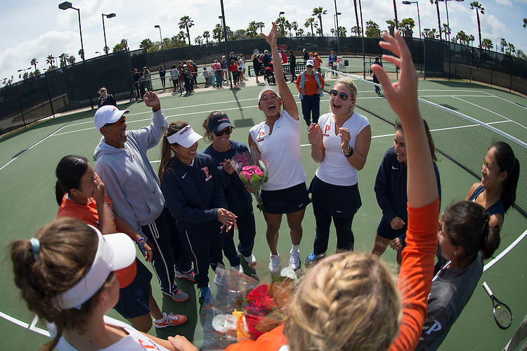 April 26, 2014; San Diego, CA, USA; Pepperdine Waves player Lorraine Guillermo, Matea Cutura, Alejandra Granillo, Michaela Capannolo, Yuki Chiang, Apichaya Runglerdkriangkrai, Danielle Feneredis, Pattaraporn Salirathavibhaga, women's tennis coach Gualberto Escudero, assistant coach Cintia Tortorella, volunteer assistant coach Nina Eriksson during the finals of the WCC Tennis Championships at Barnes Tennis Center.