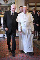 Pope Francis receives Croatia's President Ivo Josipovic at the end of a private audience in his private library at the Vatican on October 10, 2013.