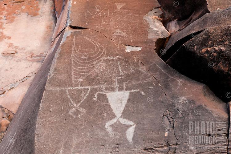 Authentic Hawaiian petroglyphs of human figures and a canoe sail, Olowalu, Maui