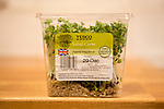 Close up of salad cress growing inside plastic Tesco container