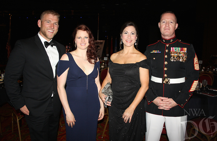 NWA Democrat-Gazette/CARIN SCHOPPMEYER Matthew Melencon and Nicole Roundy (from left) and Sarah and Sgt. Maj. Lance Nutt, Sheep Dog Impact Assistance founder and president, welcome guests to the group's charity ball April 22 at the John Q. Hammons Center in Rogers.