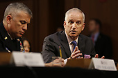 """Director Robert Cardillo, National Geospatial-Intelligence Agency (NGA) testifies before the United States Senate Select Committee on Intelligence during an open hearing on """"Worldwide Threats"""" on Capitol Hill in Washington, DC on Tuesday, January 29, 2019.  Pictured at left is Director General Paul Nakasone, National Security Agency (NSA).<br /> Credit: Martin H. Simon / CNP"""