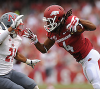NWA Media/ANDY SHUPE - Arkansas receiver Keon Hatcher (4) reaches to fend off Nicholls defensive back Josh Singleton during the second quarter Saturday, Sept. 6, 2014, at Razorback Stadium in Fayetteville