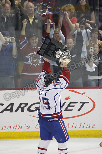 Jun 7, 2007; Hamilton, ON, CAN; Hamilton Bulldogs right winger (19) Duncan Milroy hoists the Calder Cup after defeating the Hershey Bears 2-1 in game five at Copps Coliseum in Hamilton, ON. Mandatory Credit: Ron Scheffler