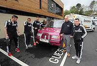 """Pictured L-R: Players Alvaro Vasquez, Wayne Routledge, Jordi Amat, Ashley Williams, new owner Leigh Evans and player Leon Britton with the Suzuki Samurai at the Landore Training Ground. Saturday 10 May 2014<br /> Re: Leigh Evans of Leigh Enterprise Tyres is the new owner of """"the pink Ferrari"""", an old Suzuki Samurai 4x4 car used by Swansea City FC players during the last season."""