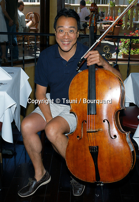 Yo Yo Ma Free Saturday Afternoon Concert at the Grove in Los Angeles to promote his new CD &quot; Obrigado Brazil &quot;. August 9, 2003.<br /> <br /> posing with his violoncelle