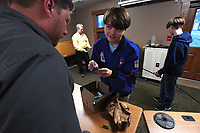 NWA Democrat-Gazette/J.T. WAMPLER Case Kirk, Elkins Robotics/Electronics Club member, talks about electronic components with Matt Francis (LEFT)  while working on a lighting project for the University of Arkansas apparel merchandising department for their annual fashion show Wednesday March 28, 2018 at the Elkins Public Library. The club is constructing and programming a series of lighted arches that will respond as the models walk the runway. The club is sponsored and mentored by the Institute of Electrical and Electronics Engineers and Ozark Integrated Circuits. Francis is the president and CEO of Ozark Integrated Circuits.
