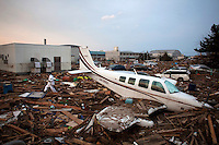 A rescue worker searches for bodies amongst cars and planes among extensive debris at Sendai airport. On 11 March 2011 a magnitude 9 earthquake struck 130 km off the coast of Northern Japan causing a massive Tsunami that swept across the coast of Northern Honshu. The earthquake and tsunami caused extensive damage and loss of life.