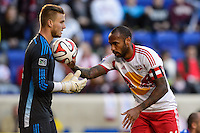 Thierry Henry (14) of the New York Red Bulls hands the ball to Colorado Rapids goalkeeper John Berner (12) during second half stoppage time. The New York Red Bulls and the Colorado Rapids played to a 1-1 tie during a Major League Soccer (MLS) match at Red Bull Arena in Harrison, NJ, on March 15, 2014.