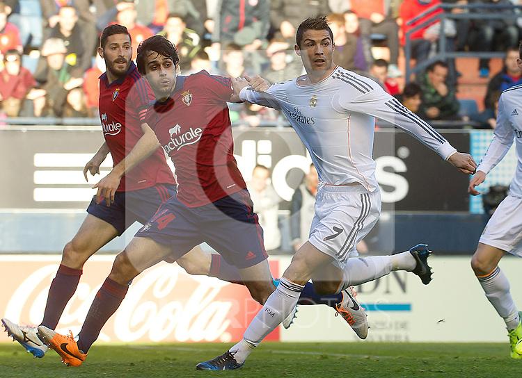 Osasuna's Damia Abella (l) and Alejandro Arribas (c) and Real Madrid's Cristiano Ronaldo during La Liga match.December 14,2013. (ALTERPHOTOS/Mikel)
