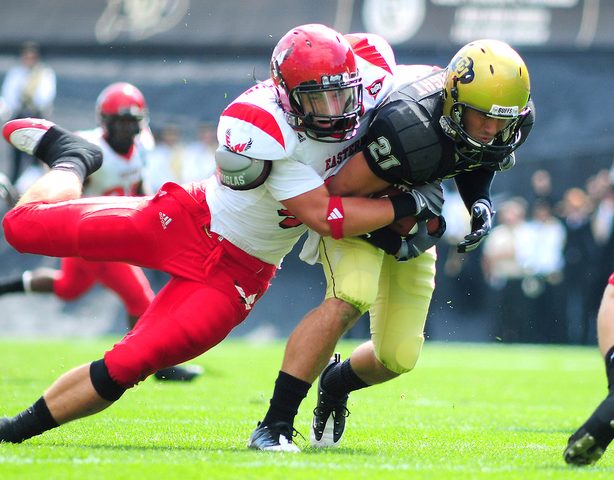 06 September 08: Eastern Washington linebacker Zach Johnson (white/red) wraps up Colorado Wide Receiver Scotty McKnight. The Colorado Buffaloes defeated the Eastern Washington Eagles 31-24 at Folsom Field in Boulder, Colorado. FOR EDITORIAL USE ONLY