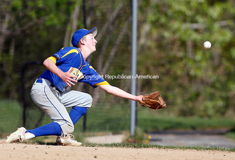 Burlington, CT- 08 May 2015-050815CM05-  Housatonic's Scott Dignacco rushes in for a pop fly during their Berkshire League matchup against Lewis Mills in Burlington on Friday.  Christopher Massa Republican-American