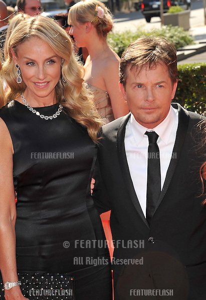 Michael J. Fox & wife Tracy Pollan at the 2012 Primetime Creative Emmy Awards at the Nokia Theatre, LA Live..September 15, 2012  Los Angeles, CA.Picture: Paul Smith / Featureflash