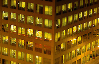 A city office building with lights at night.