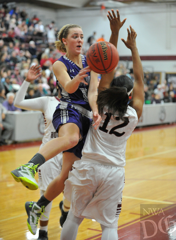 NWA Democrat-Gazette/MICHAEL WOODS • @NWAMICHAELW<br /> Fayetteville's Grace Spangler (3) tries to drive to the hoop past Springdale defender Maya Hood (12) Friday, January 15, 2016 during their game at Springdale High School.