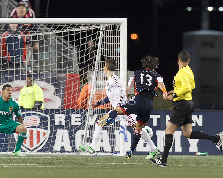 New England Revolution midfielder Ryan Guy (13) scores in lower corner. In a Major League Soccer (MLS) match, Real Salt Lake (white)defeated the New England Revolution (blue), 2-1, at Gillette Stadium on May 8, 2013.