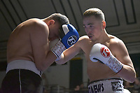 Alex Hughes (white shorts) defeats Adam Grabiec during a Boxing Show at York Hall on 30th November 2018