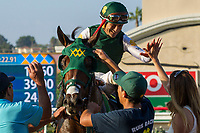 DEL MAR, CA. SEPTEMBER 4: #6 Bolt d'Oro  ridden by Corey Nakatani, returns to the connections after winning the Del Mar Futurity (Grade l) on September 4, 2017, at Del Mar Thoroughbred Club in Del Mar, CA.(Photo by Casey Phillips/Eclipse Sportswire/Getty Images)