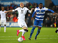 11th February 2020; Liberty Stadium, Swansea, Glamorgan, Wales; English Football League Championship, Swansea City versus Queens Park Rangers; Conor Gallagher of Swansea City is fouled by Bright Osayi-Samuel of Queens Park Rangers