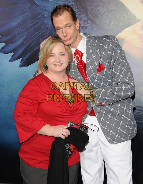 "GUEST & DOUG JONES .World Premiere of ""Legion"" held at The Arclight Cinerama Dome in Hollywood, California, USA..January 21st, 2010.half length white trousers grey gray suit jacket pattern hands top on shoulders red tie .CAP/RKE/DVS.©DVS/RockinExposures/Capital Pictures."