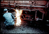 Close up of workman by gondola's truck (Flame or liquid falling to ground)?<br /> D&amp;RGW