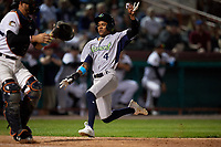 Vermont Lake Monsters center fielder Jeramiah McCray (4) slides into home plate in front of catcher Oscar Campos (2) during a game against the Tri-City ValleyCats on June 16, 2018 at Joseph L. Bruno Stadium in Troy, New York.  Vermont defeated Tri-City 6-2.  (Mike Janes/Four Seam Images)