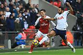 10th February 2018, Wembley Stadium, London England; EPL Premier League football, Tottenham Hotspur versus Arsenal; Mousa Dembele of Tottenham Hotspur tackles Mesut Ozil of Arsenal