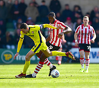 Lincoln City's John Akinde battles with Cheltenham Town's Ben Tozer<br /> <br /> Photographer Andrew Vaughan/CameraSport<br /> <br /> The EFL Sky Bet League Two - Lincoln City v Cheltenham Town - Saturday 13th April 2019 - Sincil Bank - Lincoln<br /> <br /> World Copyright &copy; 2019 CameraSport. All rights reserved. 43 Linden Ave. Countesthorpe. Leicester. England. LE8 5PG - Tel: +44 (0) 116 277 4147 - admin@camerasport.com - www.camerasport.com