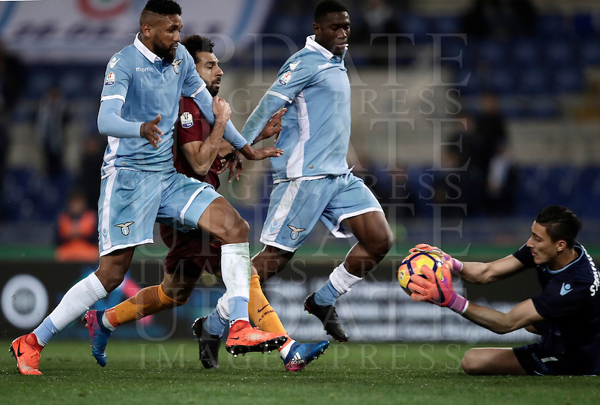 Calcio, Serie A: Roma, stadio Olimpico, 1marzo 2017.<br /> Roma's Mohamed Salah (c), between Lazio's Fortuna Dos Santos Wallace (r) and Jacinto Quissanga Bastos (l), tries to score against Lazio's goalkeeper Thomas Strakosha (r) during the Italian TIM Cup 1st leg semifinal football match between Lazio and AS Roma at Rome's Olympic stadium, on March 1, 2017.<br /> UPDATE IMAGES PRESS/Isabella Bonotto