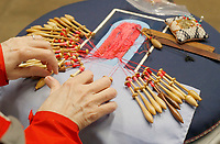 NWA Democrat-Gazette/DAVID GOTTSCHALK The hands of Peggy Bowen are visible Wednesday, February 6, 2019, as she works on Bobbin Lace during a Spin-A-Round meeting of the Wool and Wheel Handspinners in the Latta Barn at Prairie Grove Battlefield State Park. The group meets every first Wednesday of the month at the park and every third Saturday at Ozark Folkways in Winslow. The group is open to the public and invites participation and observation.