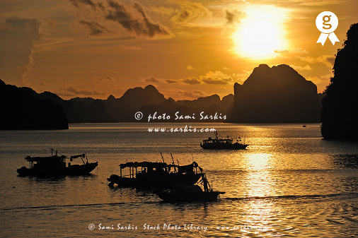 Junk boat navigating in Halong Bay (Licence this image exclusively with Getty: http://www.gettyimages.com/detail/83154170 )